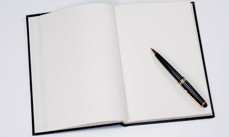Blank pages in a notebook with a pen