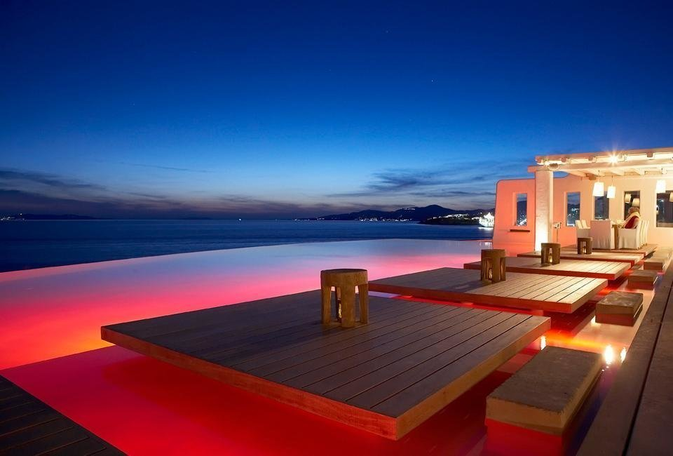 The couple booked a room at Cavo Taggo, and they enjoyed sunbathing in floating sunbeds on the infinity pool.